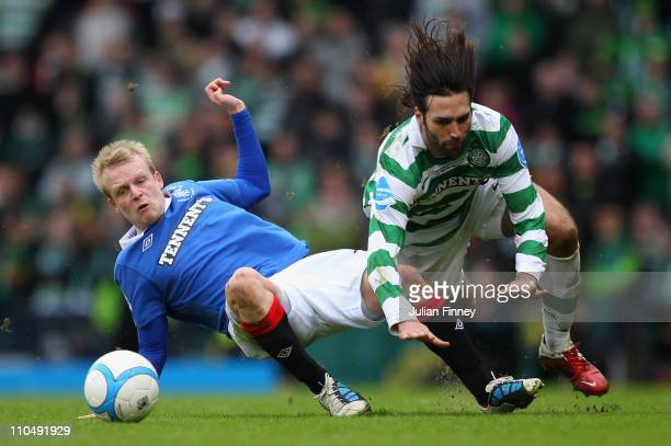 Steven Naismith of Rangers clashes with Georgios Samaras of Celtic during the Co-operative Insurance Cup final between at Hampden Park on March 20,...