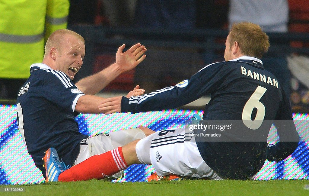 Steven Naismith of Scotland celebrates his goal Barry Bannan during the FIFA 2014 World Cup Qualifying Group A match between Scotland and Croatia at Hampden Park on October 15, 2013.