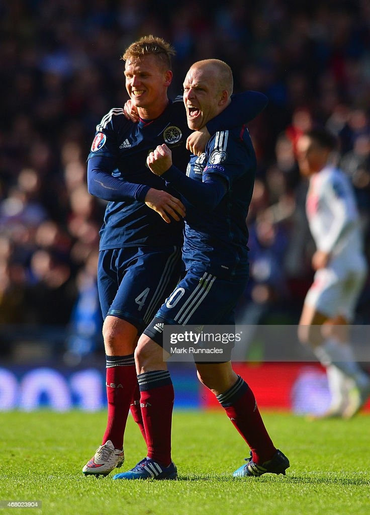 Steven Naismith of Scotland (R) celebrates scoring their fourth goal with Matt Ritchie of Scotland during the EURO 2016 Qualifier match between Scotland and Gibraltar at Hampden Park on March 29, 2015 in Glasgow, Scotland.