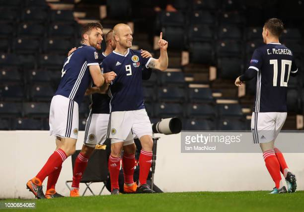 Steven Naismith of Scotland celebrates with team mates as Berat Gjimshiti of Albania scores an own goal fortheir first goal during the UEFA Nations...