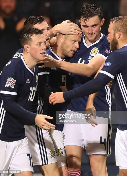 Steven Naismith of Scotland is congratulated after scoring the opening goal during the UEFA Nations League C group one match between Scotland and...
