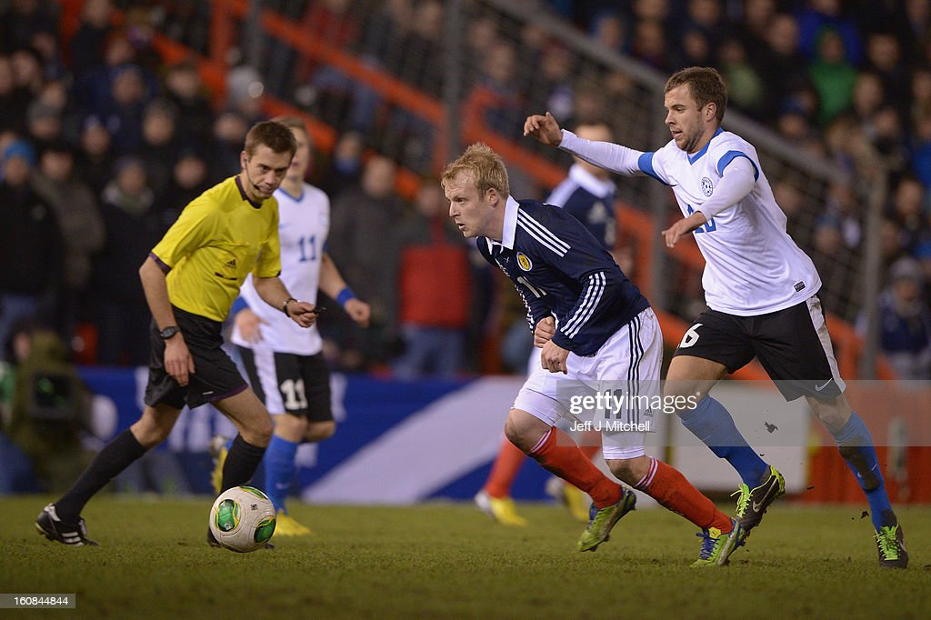 Steven Naismith of Scotland tackles Sergi Mosnikov of Estonia during the international friendly match between Scotland and Estonia at Pittodrie Stadium on February 6, 2013 in Aberdeen, Scotland.