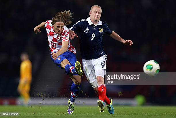 Steven Naismith of Scotland vies with Luka Modric of Croatia during the 2014 World Cup Group A qualifying football match between Scotland and Croatia...