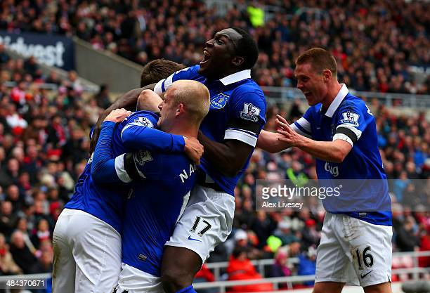 Steven Naismith Romelu Lukaku and James McCarthy of Everton celebrate after Wes Brown of Sunderland scores an own goal during the Barclays Premier...