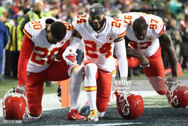 Steven Nelson Jordan Lucas and Allen Bailey of the Kansas City Chiefs pray together on the field before the game against the Seattle Seahawks at...