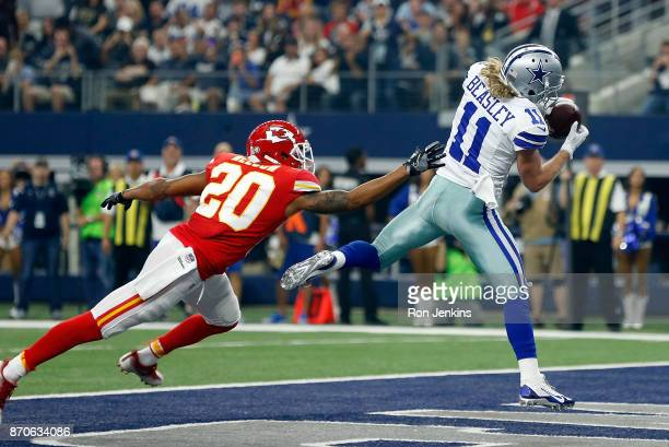 Steven Nelson of the Kansas City Chiefs defends as Cole Beasley of the Dallas Cowboys pulls in a pass for a touchdown in the first quarter of a...