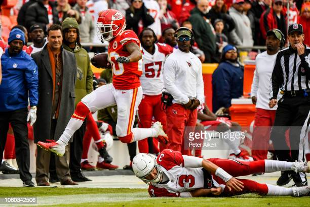 Steven Nelson of the Kansas City Chiefs jumps over the tackle attempt of Josh Rosen of the Arizona Cardinals during the second half of the game at...