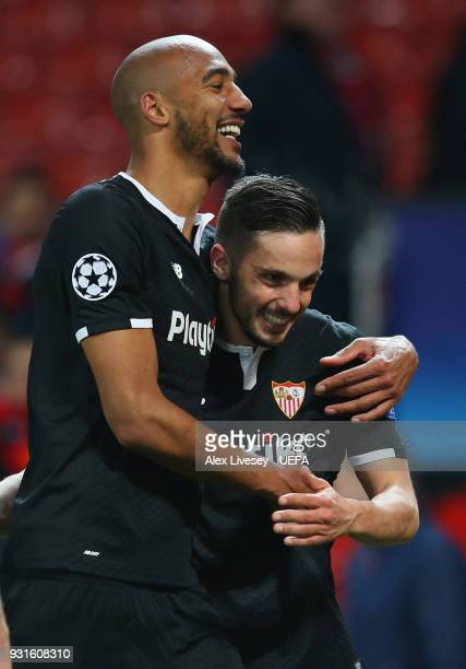 Steven N'zonzi and Pablo Sarabia of Sevilla FC celebrate after the UEFA Champions League Round of 16 Second Leg match between Manchester United and...