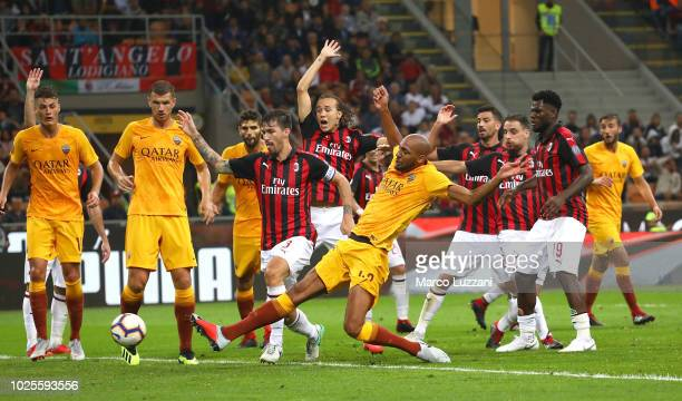 Steven Nzonzi of AS Roma scores a disallowed goal by the var during the serie A match between AC Milan and AS Roma at Stadio Giuseppe Meazza on...