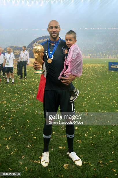 Steven N'Zonzi of France poses with his daughter and the trophy after the 2018 FIFA World Cup Russia Final between France and Croatia at the Luzhniki...