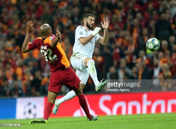 Steven Nzonzi of Galatasaray and Karim Benzama of Real Madrid vie for the ball during the UEFA Champions League Group A match between Galatasaray and...