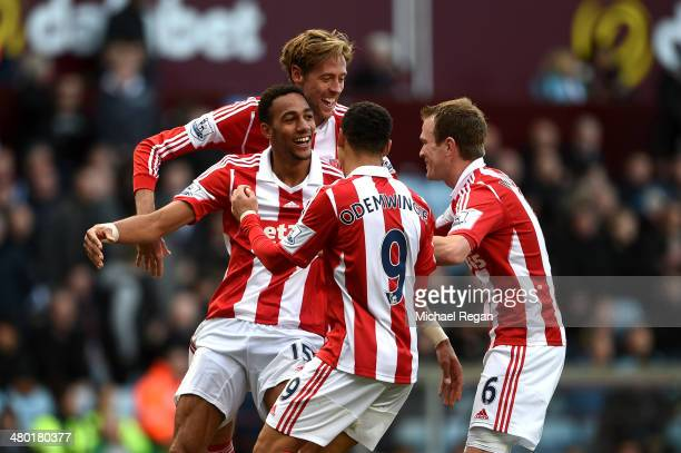 Steven N'Zonzi of Stoke is congratulated by teammates after scoring his team's third goal during the Barclays Premier League match between Aston...