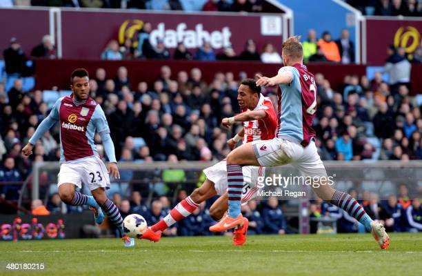 Steven N'Zonzi of Stoke scores his team's third goal during the Barclays Premier League match between Aston Villa and Stoke City at Villa Park on...