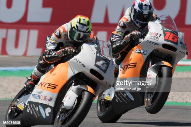 Steven Odendaal of South Africa and NTS RW Racing GP and Joe Roberts of USA and NTS RW Racing GP lift the front wheel during the Moto2 race during...