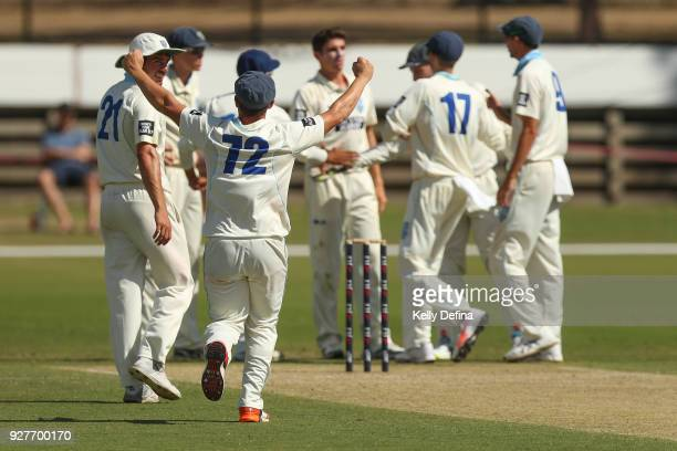 Steven O'Keefe celebrates with the NSW Blues during day one of the Sheffield Shield match between Victoria and New South Wales at Junction Oval on...