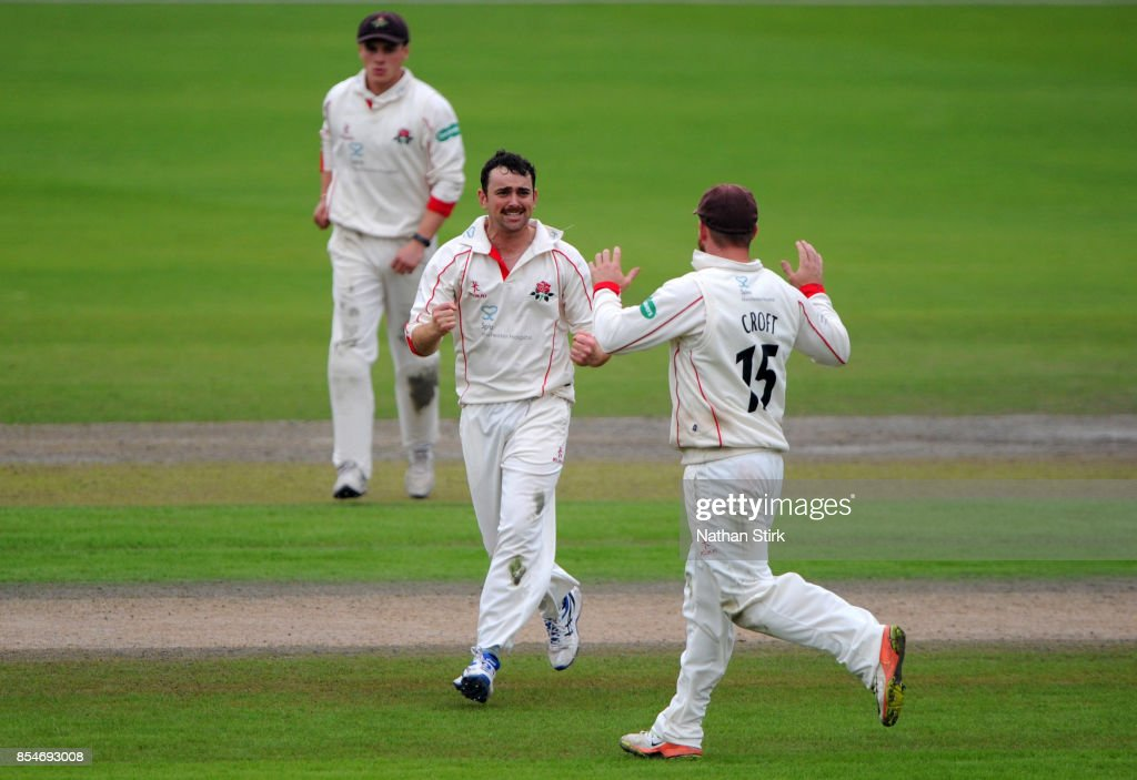 Steven Parry of Lancashire celebrates getting a wicket during the County Championship Division One match between Lancashire and Surrey at Old Trafford on September 27, 2017 in Manchester, England.