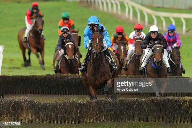 Steven Pateman riding Palmero jumps the Tozer Rd steeple before winning Race 6 the Scotty Stewart Brierly Steeplechase during the Warnambool May...