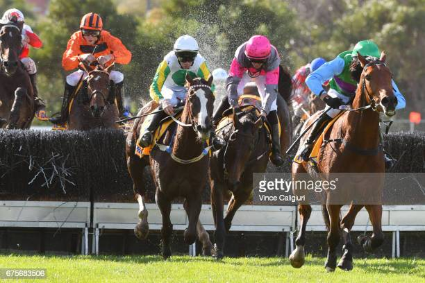 Steven Pateman riding Zed Em races away after jumping the last steeple to defeat John Allen riding Now and Zen and Shane Jackson riding Gold Medals...