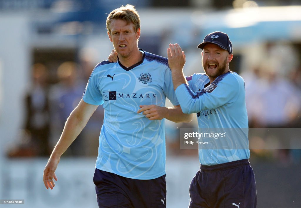 Steven Patterson of Yorkshire Vikings celebrates with Adam Lyth after the dismissal of Ravi Bopara of Essex Eagles on the ground during the Royal London One-Day Cup match between Essex Eagles and Yorkshire Vikings at the Cloudfm County Ground on June 14, 2018 in Chelmsford, England.