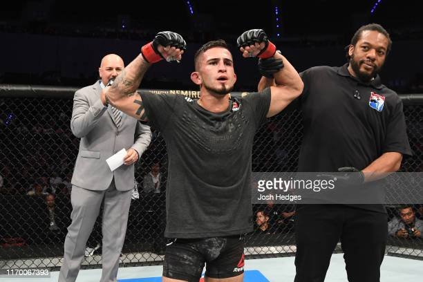 Steven Peterson celebrates his victory over Tyson Nam in their flyweight bout during the UFC Fight Night event on September 21, 2019 in Mexico City,...