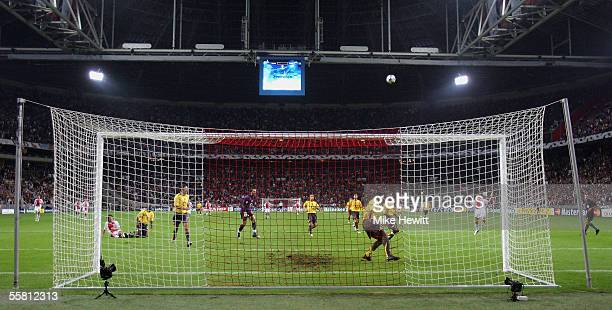 Steven Pienaar of Ajax blasts over with the goal at his mercy on the stroke of halftime during the UEFA Champions League Group B match between Ajax...