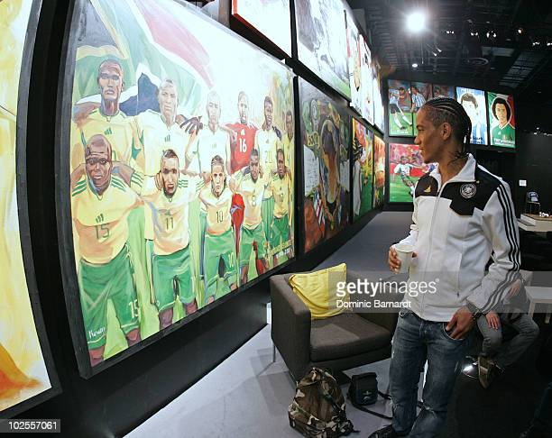 Steven Pienaar of Bafana Bafana has a look at paintings done during 2010 FIFA World Cup at the adidas Jo'bulani Centre in Sandton on June 28 2010 in...