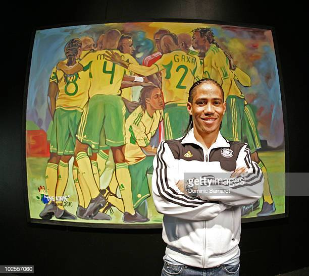 Steven Pienaar of Bafana Bafana poses with portraits of himself that he has signed which were painted during the 2010 FIFA World Cup at the adidas...