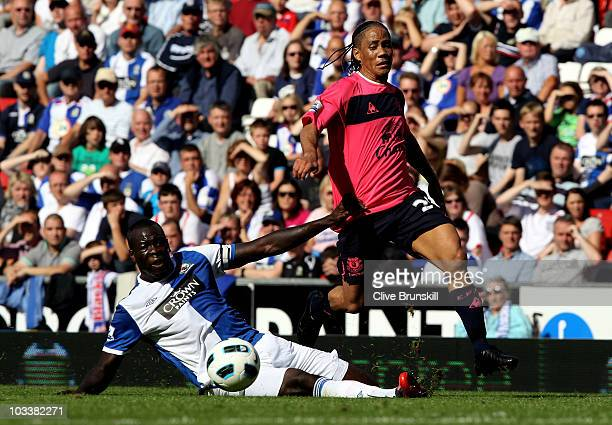 Steven Pienaar of Everton attempts to move away from Chris Samba of Blackburn Rovers during the Barclays Premier League match between Blackburn...