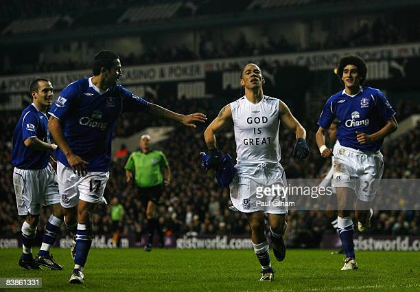 Steven Pienaar of Everton celebrates with with his teammates after scoring the first goal for Everton during the Barclays Premier League match...