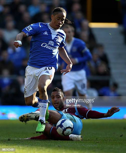 Steven Pienaar of Everton goes past the tackle of Mido of West Ham United during the Barclays Premier League match between Everton and West Ham...