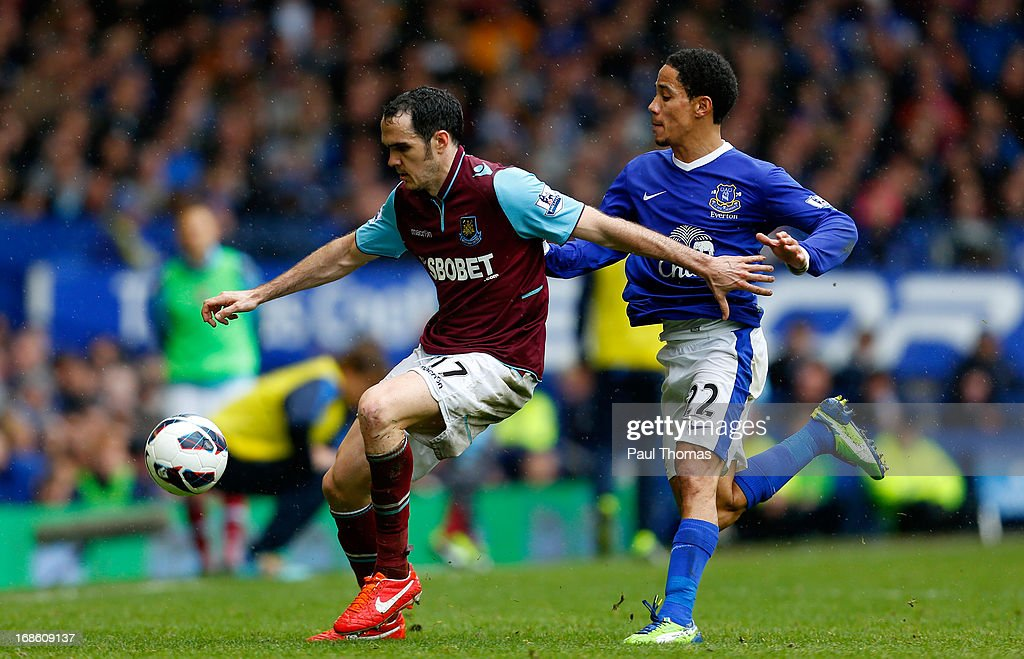 Steven Pienaar (R) of Everton in action with Joey O'Brien of West Ham during the Barclays Premier League match between Everton and West Ham United at Goodison Park on May 12, 2013 in Liverpool, England.