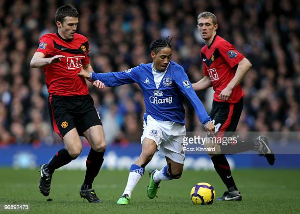 Steven Pienaar of Everton is challenged by Michael Carrick of Manchester United during the Barclays Premiership match between Everton and Manchester...