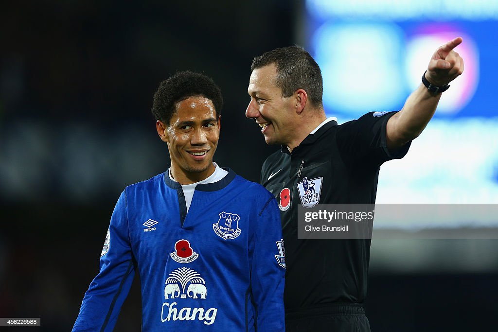 Steven Pienaar of Everton shares a joke with Referee Kevin Friend during the Barclays Premier League match between Everton and Swansea City at Goodison Park on November 1, 2014 in Liverpool, England.