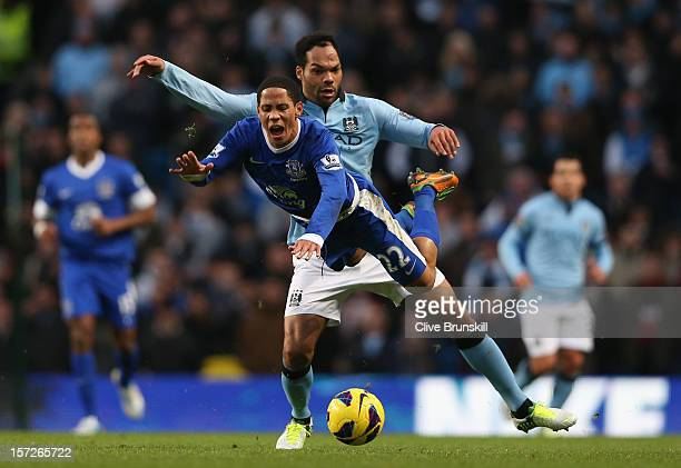 Steven Pienaar of Everton tangles with Joleon Lescott of Manchester City during the Barclays Premier League match between Manchester City and Everton...