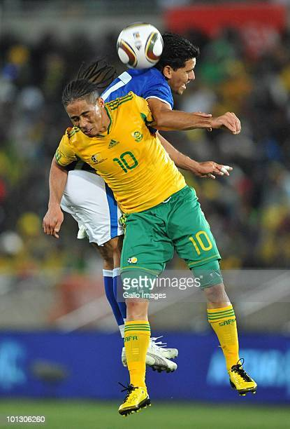 Steven Pienaar of South Africa competes in the air with Carlos Gasrillo of Guatamala during the International Friendly match between South Africa and...