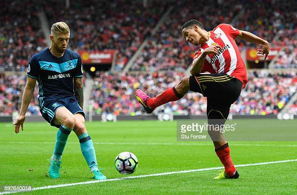 Steven Pienaar of Sunderland is closed down by Adam Clayton of Middlesbrough during the Premier League match between Sunderland and Middlesbrough at...