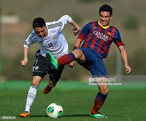 Steven Prieto of Barcelona competes for the ball with Oguzhan Aydogan of Germany during the friendly match between U18 FC Barcelona and U17 Germany...