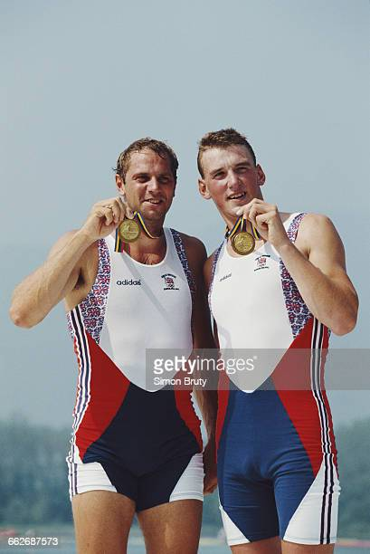 Steven Redgrave and Matthew Pinsent of Great Britain celebrate with their gold medals after winning the Men's Coxless Pairs rowing event during the...