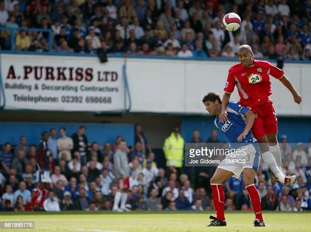Steven Reid, Blackburn wins the header against Dejan Stefanovic of Portsmouth
