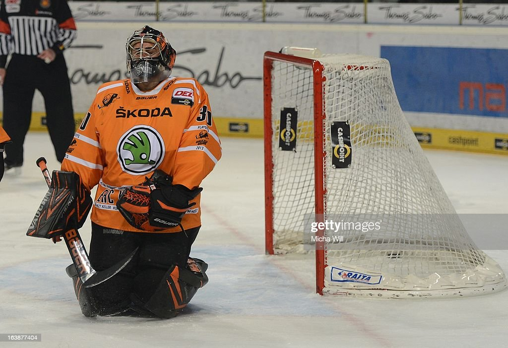 Steven Reinprecht (not in the picture) of Nuremberg scores the first goal against goalie Daniar Dshunussow of Wolfsburg during game three of the DEL pre-play-offs between Thomas Sabo Ice Tigers and Grizzly Adams Wolfsburg on March 17, 2013 in Nuremberg, Germany.