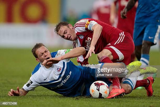 Steven Ruprecht of Rostock and Rafael Kazior of Kiel compete during the Third League match between Hansa Rostock and Holstein Kiel at DKBArena on...