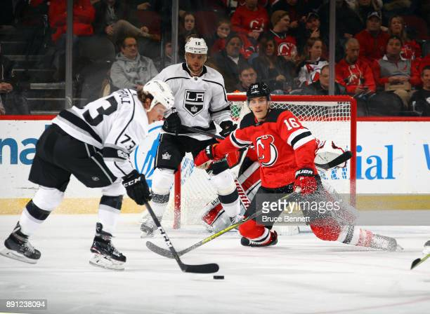 Steven Santini of the New Jersey Devils drops to the ice to block a second period shot from Tyler Toffoli of the Los Angeles Kings at the Prudential...