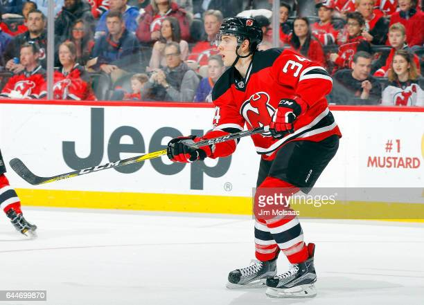 Steven Santini of the New Jersey Devils in action against the New York Islanders on February 18 2017 at Prudential Center in Newark New Jersey The...