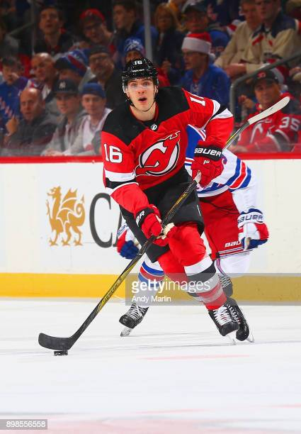 Steven Santini of the New Jersey Devils plays the puck during the game against the New York Rangers at Prudential Center on December 21 2017 in...