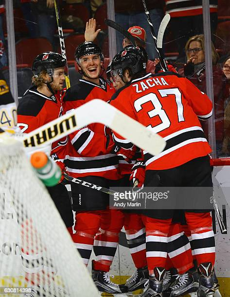 Steven Santini of the New Jersey Devils reacts after scoring his first NHL point an assist to teammate PA Parenteau during the game against the...