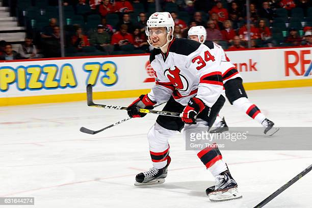 Steven Santini of the New Jersey Devils skates against the Calgary Flames during an NHL game on January 13 2017 at the Scotiabank Saddledome in...