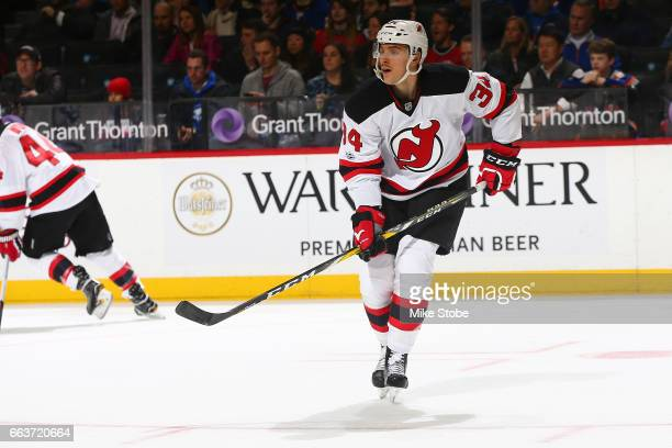 Steven Santini of the New Jersey Devils skates against the New York Islanders at the Barclays Center on March 31 2017 in Brooklyn borough of New York...