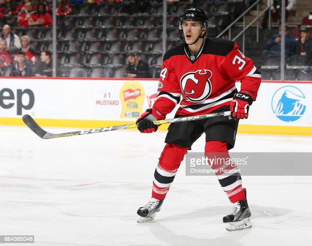Steven Santini of the New Jersey Devils skates during the first period against the Winnipeg Jets on March 28 2017 at the Prudential Center in Newark...