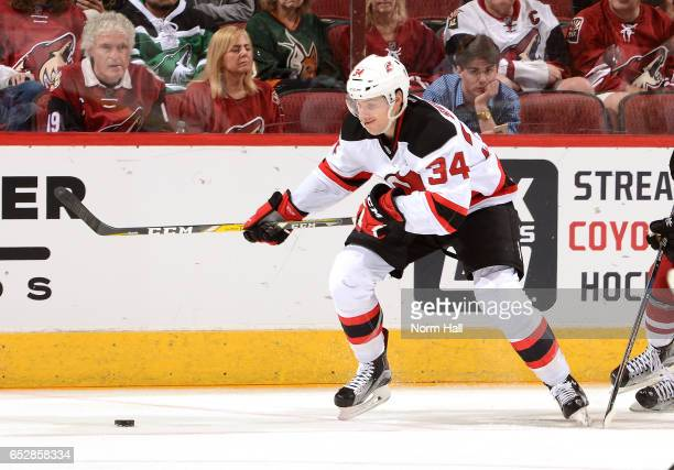 Steven Santini of the New Jersey Devils skates with the puck against the Arizona Coyotes at Gila River Arena on March 11 2017 in Glendale Arizona