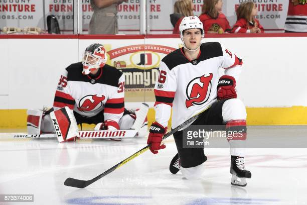 Steven Santini of the New Jersey Devils warms up prior to the game against the Chicago Blackhawks at the United Center on November 12 2017 in Chicago...
